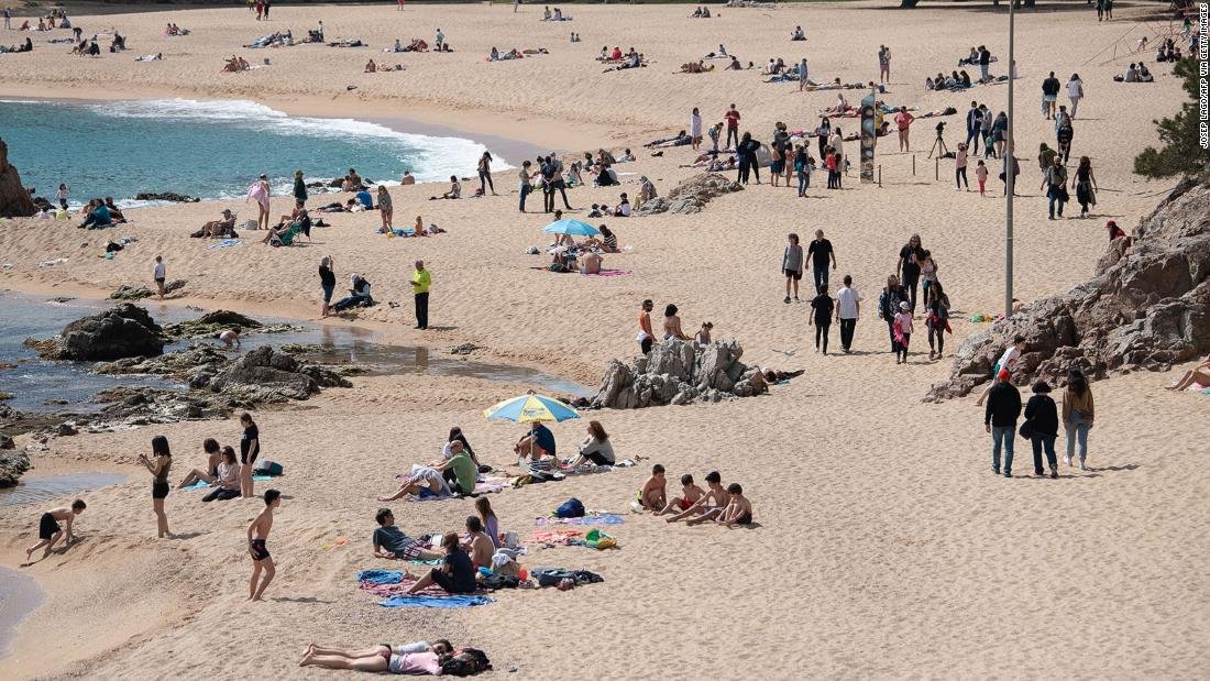 210507121313 sunbathers on the beach sa conca spain getty images super 169 7DIPqf
